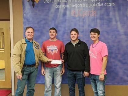 """<p class=""""body"""">UNION CITY, Ind. – Students from Union City High School and Mississinawa Valley High School assisted the Union City Lions Club with their Semi-Annual Pancake and Sausage Breakfast which was held on Nov. 2 at the Union City Elks Club. The Lions thank the community for supporting this event in which approximately 480 people were served. All proceeds are used to support community events and state Lions projects. Pictured UC Lion and Randolph Eastern Technology Director Blake Clevenger presenting a donation to student helpers Braxton Wright, AVID; Jayden Hindsley, Football Team; and. Derick Williams, National Honor society. Mississinawa Valley students were not available for the photo."""