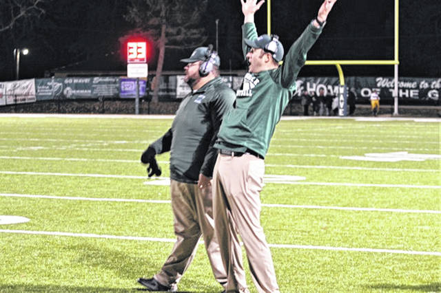 Greenville head varsity football coach celebrates as the last second ticks off the clock in the Wave's senior night win to giving the team a winning 7-3 season record to go along with the return of the Little Brown Jug.