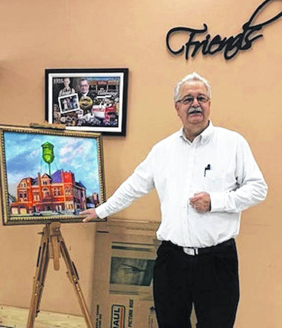 Former Arcanum resident Roger Snell recent;y unveiled his painting 'A New Day in Arcanum,' which will be sold with proceeds going to the Arcanum Preservation Society.