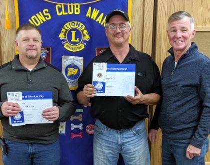 Shown are new members Rob Myers, Dean Coats and Lion Larry Amspaugh, membership chairman and sponsor of the new members.