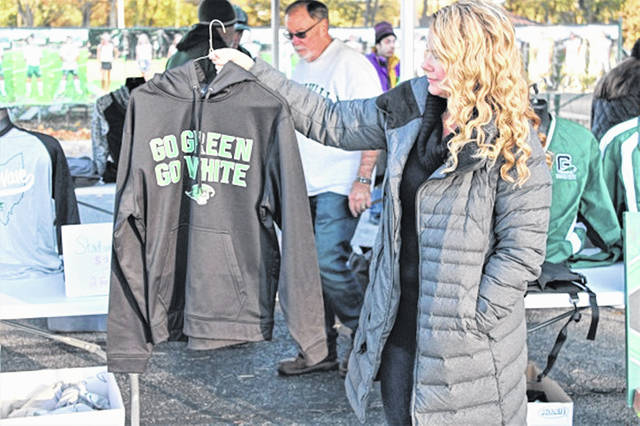 Jamie McGillivary shows a Greenville hooded sweatshirt from the Boosters' Spirit Wagon.