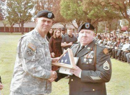 Staff Sergeant Kevin Malonee (right) is shown at his retirement ceremony.