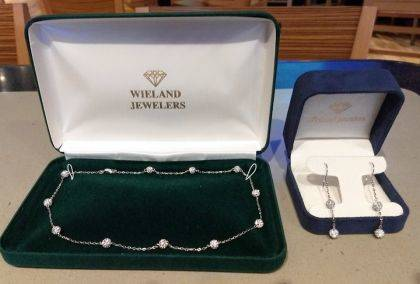 The necklace and earrings are donated by Wieland Jewelers.