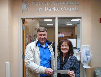 Tim Burns, Mercer Savings Bank, presented a donation to Christine Lynn, executive director of Cancer Association of Darke County.