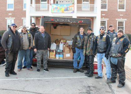 GREENVILLE – For the fifth consecutive year, local veterans will have a great Thanksgiving dinner thanks to the Road Hoggs Motorcycle Club and the Greenville VFW. On Sunday, members of the club collected food in front of the Greenville City Building. According to Matt Townsend, this year's drive wasn't there best, but they did well. They collected 10-12 turkeys, several hams and Coopers donated about 50 pounds of meat. The group also collected cash that will be turned into gift cards. In a few weeks, the Road Hoggs will be on the traffic circle collecting toys that will be given to the Community Action Partnership for distribution. This will be 36th year for the toy drive.