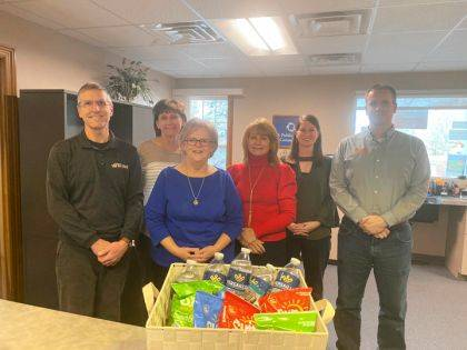 The staff at Versailles Rehabilitation & Healthcare presented a gift basket to the Village of Versailles Administrative Offices.