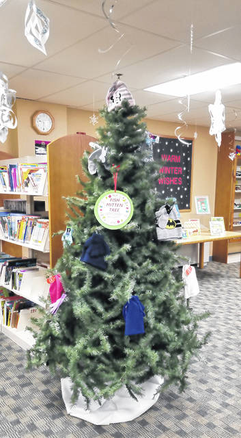 Bethany J. Royer-DeLong | Darke County Media The Mitten Tree has been a county tradition for the last 50 years with the Greenville Public Library participating for the first time. Donations of mittens, gloves, and hats will be accepted from now until Monday, Dec. 16.