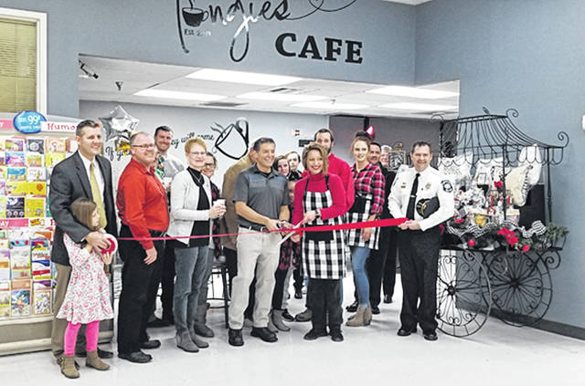Bethany J. Royer-DeLong | Darke County Media Tangies Café in Sutton's Foods Grocery Store made their opening official with a ribbon-cutting on Tuesday.