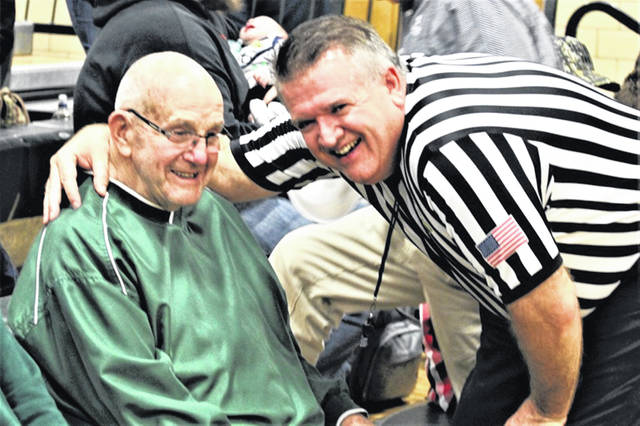 Above, Mr. Fred Matix, left, is greeted by Kevin Forrer of Troy. Forrer was officiating the Nov. 29 game between Greenville and Troy at GHS. Forrer is an OHS assigner for high school officials. Mr. Matix was an OHSAA assigner for volleyball officials.