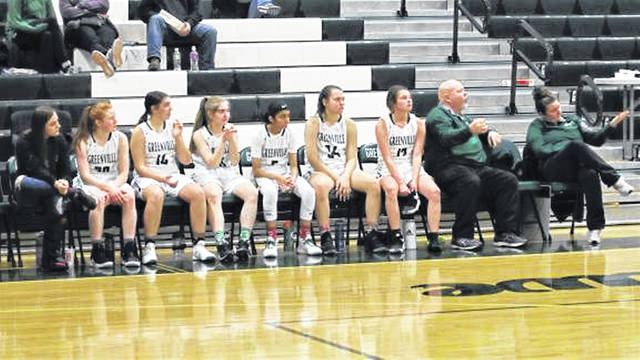 The Lady Wave starters and coaches Steve Liette (L) and Laura Germann (R) watch the final minutes tick off in Greenville's MVL win over Xenia.