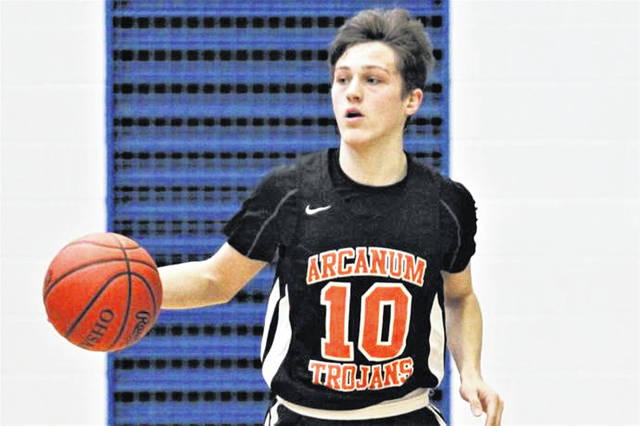 Jake Goubeaux brings the ball up-court for Arcanum in the Trojans win over Mississinawa Valley at the Jet Holiday Tournament.