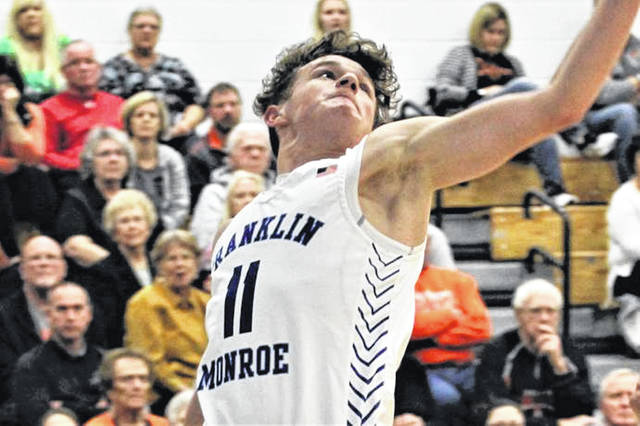 Jayce Byers scores two of his game high 24-points in Jet Holiday Tournament win over Arcanum.