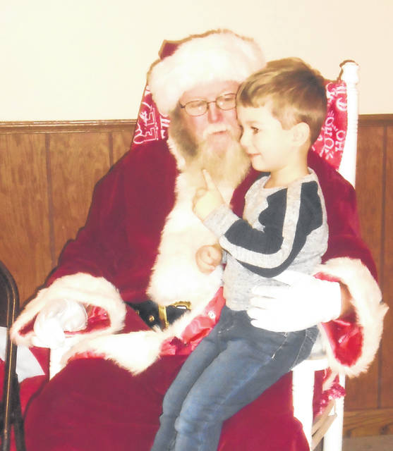 Tristen Livingston was glad to be the first one in line to sit up Santa's Lap at the Breakfast with Santa in Ansonia Saturday morning.