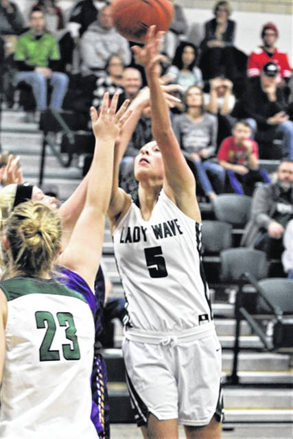Greenville's Abbie Yoder puts up a shot against Eaton in the Lady Wave's home opener.