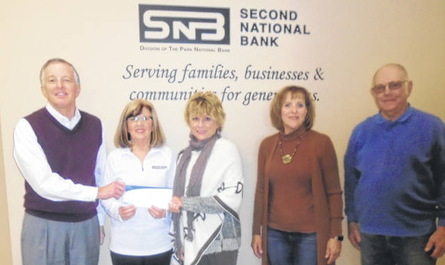 Second National Bank President John Sallow and Communtiy Relations Coordinator Vickie Wessling, far left, presented members of the Friends of Bear's Mill with a $10,000 check for its capital campaign project. The Friends members are, from left to right, Kim Rudnick, president; Lin Roberts; and Gordon Smith, treasurer.
