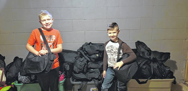 Bookbags, such as these, were handed out at the Grace Resurrection Community Center during its Thanksgiving meal, thanks to an unnamed local family who wanted to help others.