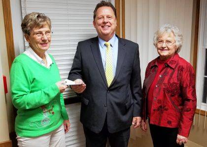 Darke County Republican Women's Club Assistant Treasurer Carol Ginn (L) and President Betty Hill (R) presented a donation to Brethren Retirement Community Chief Financial Officer Carl Eubanks (C).