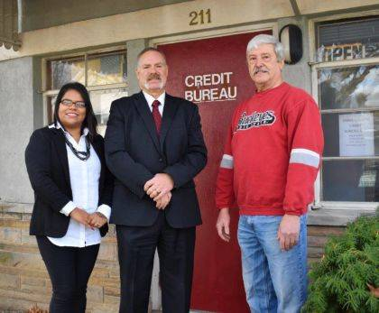 Pictured above are Cristina Hernandez, the new voice and face of Darke County Credit Bureau, Paul Wagner of the Hanes Law Group and Chris Palmer, former owner of the Darke County Credit Bureau.