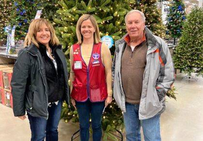Debbie Nisonger and Rick Birt are shown with Tiffany Thompson, Lowe's store manager.