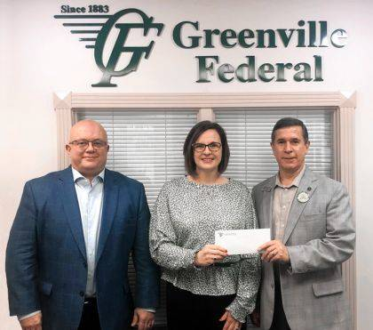 Jeff D. Kniese, president and CEO of Greenville Federal, presented a check to DCCA Executive Director Andrea Jordan and DCCA Artistic Director David Warner.
