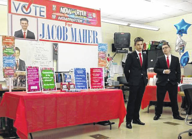GHS junior Jacob Maher, left, with campaign manager Aaron Matthew, speaks during a reception in his honor on Monday at the Career Technology Center.