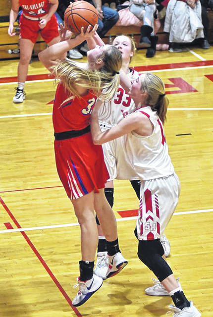 Maddie Downing scores two of her game high 17 points to lead the Tri-Village Lady Patriots over St. Henry.