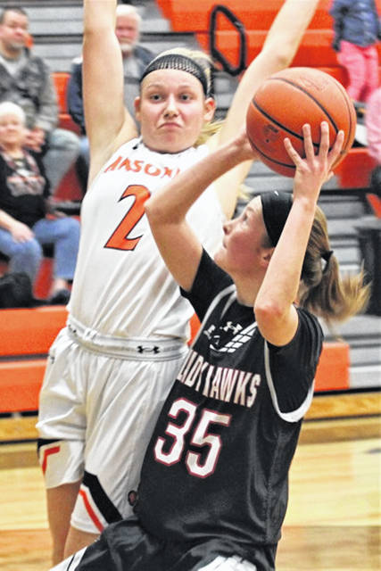 Ansonia's Mariah Troutwine (2) defends against the Lady Hawks Mattie Hiestand (35) in Saturday afternoon basketball contest.