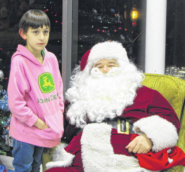 Addie King got the opportunity to meet and talk with Santa Claus at the Rossburg Fire Department Winter Wonderland. the 8-year-old is the daughter of Kristina and the late Heath Gessler. Sixty-two children were at the event with Addie.