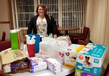 Director of Rustic Hope Connie McEldowney and the donations from Darke County Republican Women's Club members.