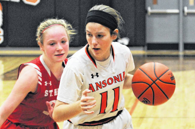 Sky Edwards drives to the basket for Ansonia in the Lady Tigers home game with the St. Henry Lady Redskins.