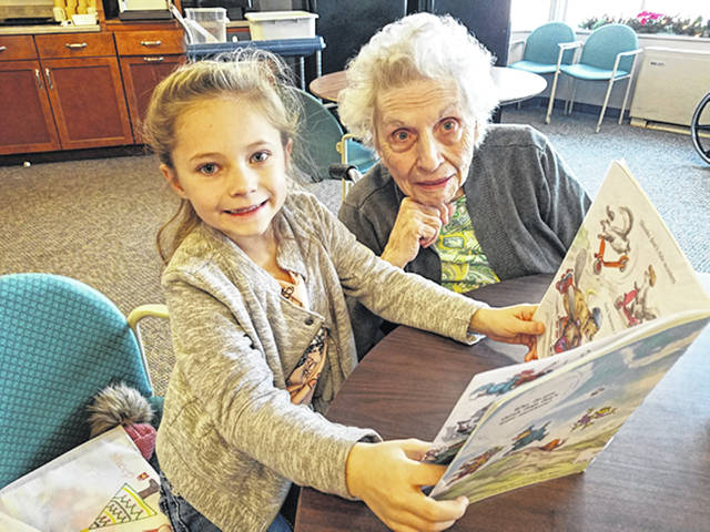 Courtesy photo BRC resident Wanda Bennett and Tri-Village second grade student Kinnley Lewis participate in Patriot Partners, a reading program established 15 years ago that aids in developing reading skills and relationships.
