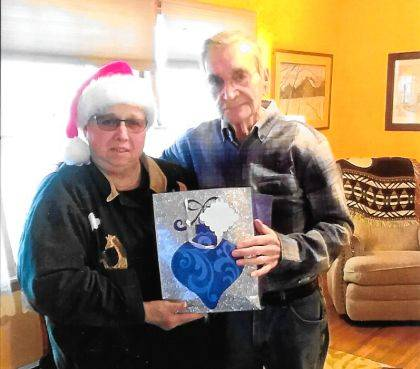"""<p class=""""body"""">NEW MADISON – Recently, Unit 245 American Legion Auxiliary member Pat Hoover delivered a Christmas Cheer Bag to Korean War veteran Ken Abernathy. This is part of the organization's outreach project to provide home visits and goodie packages to shut-ins in the Village of New Madison during the holidays."""