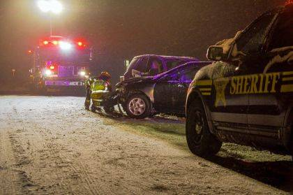 Road conditions are believed to be the cause of a two-vehicle crash that sent one person to the hospital.