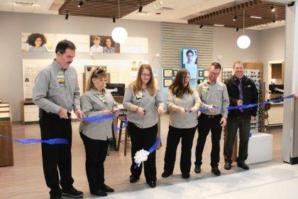 Walmart associates and Dr. Mark Beach cut the ribbon on the store's new Vision Center.