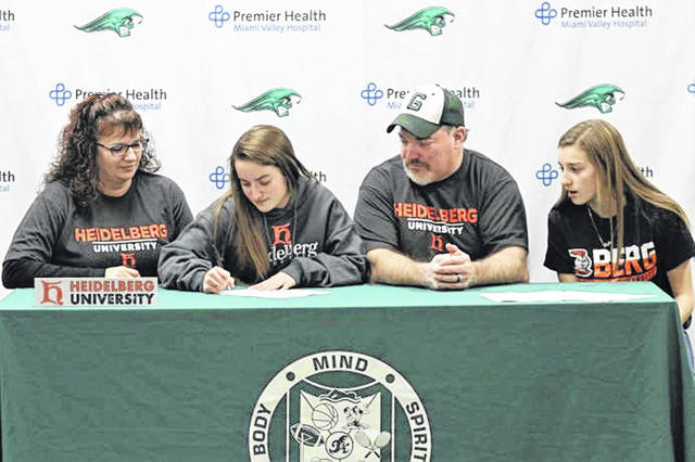 Greenville's Courtney Bryson signs to play softball for Heidelberg University. (L-R) Marlo Bryson (mother), Bryson, Ty Bryson (father) and Skylar Bryson (sister).