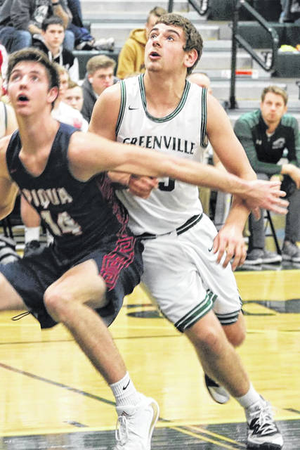Greenville's DJ Zimmer battles for a rebound in the Wave's Friday night MVL matchup with Piqua.