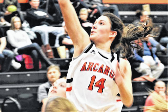Hailey Unger scores two of her game high 21-points for Arcanum in the Lady Trojans CCC win over Twin Valley South.