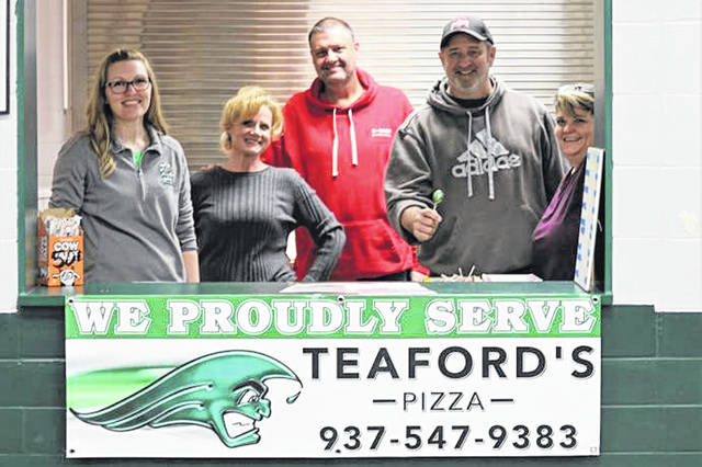Greenville Senior High School volunteer concession workers take a turn working in the schools concession stand where Teaford's Pizza is now served at all boys and girls JV and Varsity basketball games.