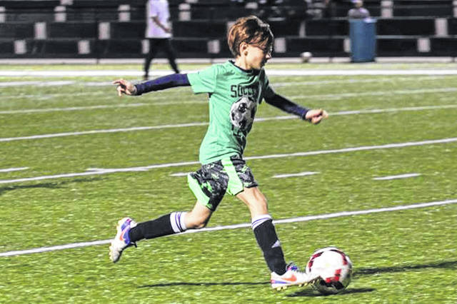 A young soccer player learns the game at a previous Greenville soccer clinic.