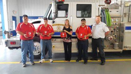 Rossburg volunteer firefighters (in red) are shown with Lauren Henry, director, Wayne HealthCare Foundation and Brian Brown, operations manager, Spirit Medical Transport.