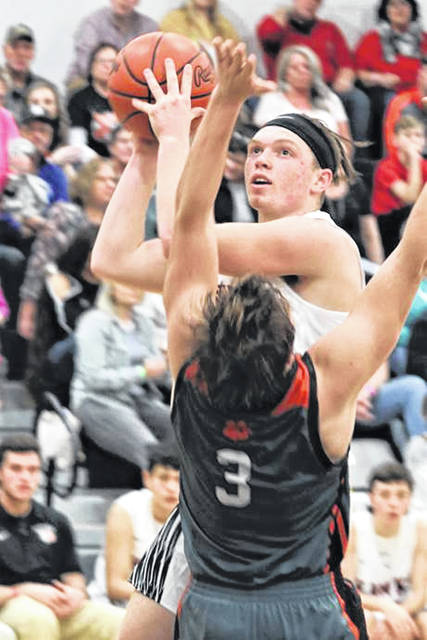 MV's Alex Scholl drives the lane in Saturday home game with Ansonia.