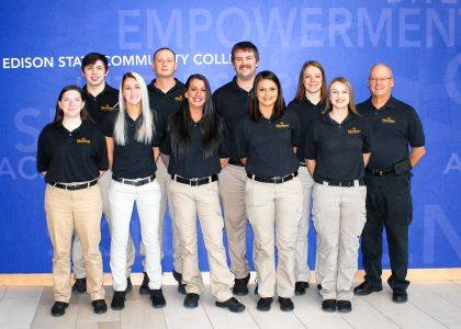 Shown are (front row) Kristen Thomas, Ragan Williams, Dorothy Stringer, Marissa Kennedy, Amber Schutte, (back row) Jacob Rife, Nathan Mahaffy, Elijah Sims, Reagan Morrett, and Commander Joe Mahan.