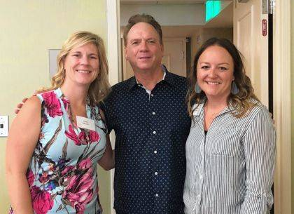 Sarah DePoy and Erin Meyer are shown with world-renowned grief counselor Dr. Alan Wolfelt.