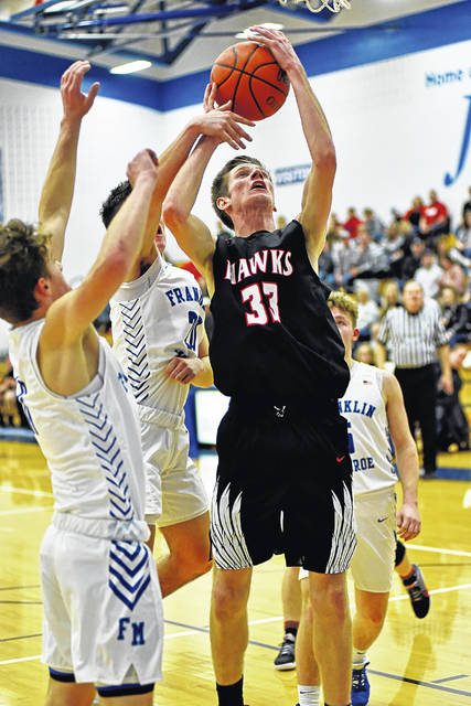 Blake Scholl goes strong to the basket for Mississinawa Valley in the Hawks OT win over Franklin Monroe.
