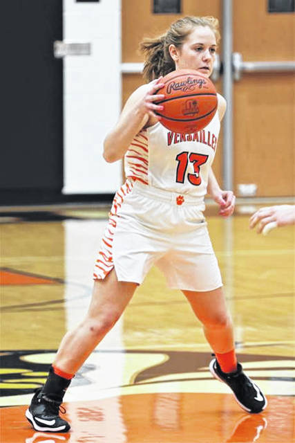 Versailles senior, Caitlin McEldowney handles the ball for the Lady Tigers in Tuesday night home game with WL-S.