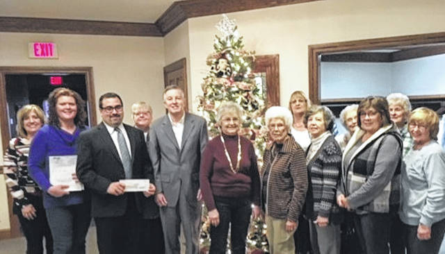 Pictured are, from left to right, Debbie Nisonger, Chris Nehring, Greg Zechar-Zechar Bailey Funeral Home, DAR Regent Brenda Arnett, Second National Bank President John Swallow, Darke County Republican Women's Club President Betty Hill and Wavelene Denniston, Fort Black Eastern Stars Linda Riley and Kathleen Gade, Sandra King, Betty Broderick, Helen Wright and Shirley Hughes.
