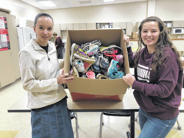 Pictured are Heather Sowers and Allison Brumbaugh, leaders of Arcanum FCCLA's shoe collection project.