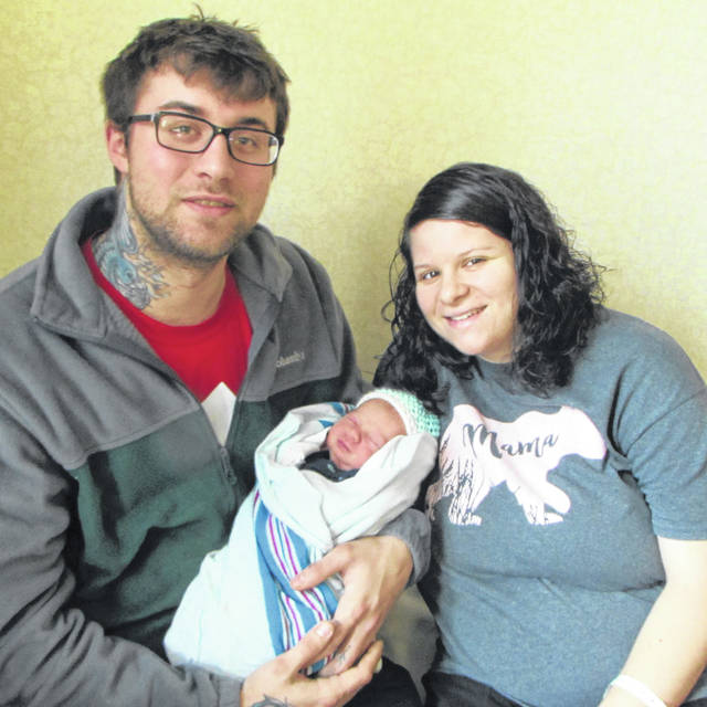 Tyler Campbell and Diana Carrubba show off their new son, Mylo, born this past Thursday evening at Wayne HealthCare. They have another son, Sylis, who will soon turn 3.