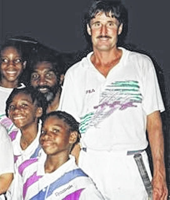 A couple of young Williams sisters, along with their dad, Richard, are shown with Rick Macci.