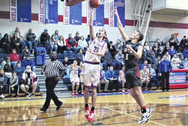 Ty Linkous scores for Tri-Village in the Patriots win over Twin Valley South.